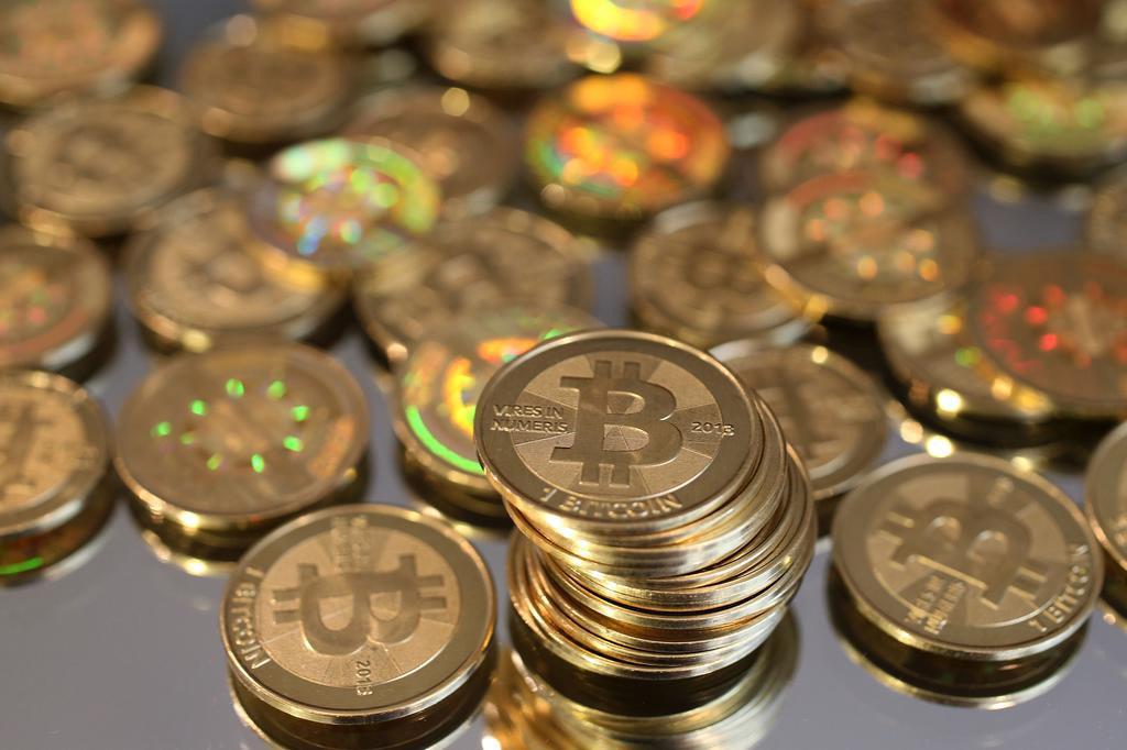 Entenda o bitcoin, moeda virtual pedida como resgate no megaciberataque George Frey,AFP/AFP