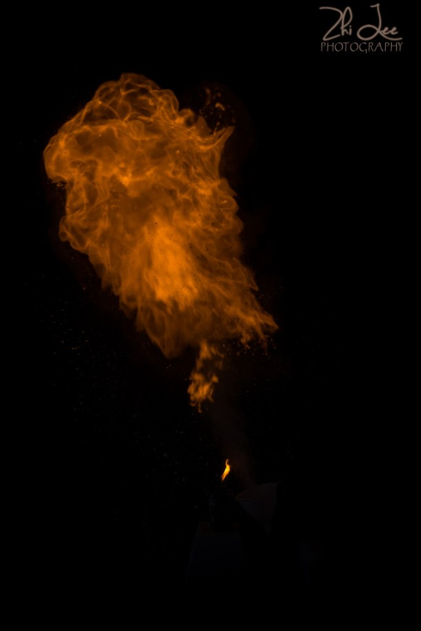 Cornflour dust in flames against a black backdrop