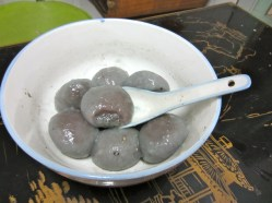 Glutinous rice balls. They're sweet and the texture is not really my cup of tea