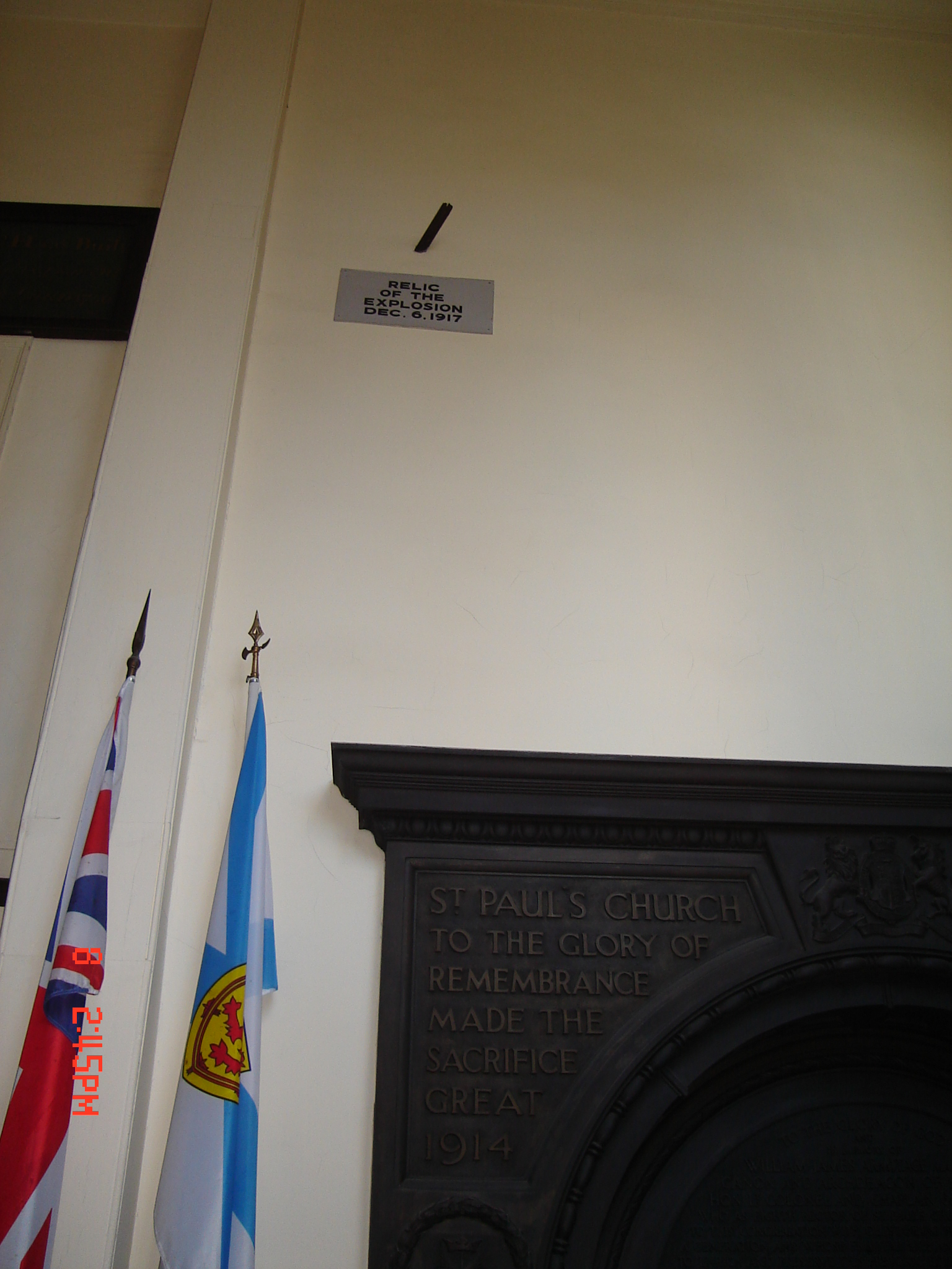 the-piece-of-metal-from-mont-blanc-remains-flown-through-the-glass-window-and-then-embedded-above-the-door-in-the-inside-wall-of-the-porch-of-st-paul_s-anglican-church1