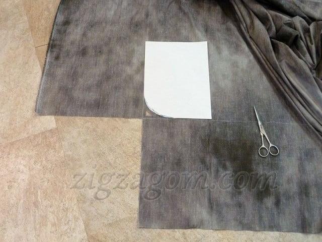 Берем лист бумаги и снимаем на него контур закругления на матрасе. Располагаем на ткани