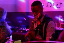 GUITAR POWER: Karabo Skabz Moeketsi plays the bass guitar and also contributes to vocals for The Muffinz during their performance at Ko'Spotong in Braamfontein.