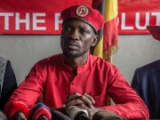"Musician and opposition candidate Bobi Wine holds a press conference, encouraging his ""people power"" supporters to continue wearing their trademark red berets in Kampala after the military banned them."