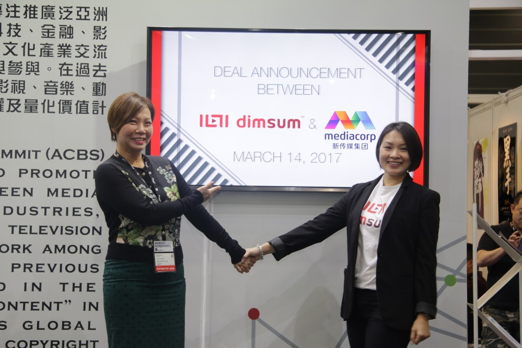 dimsum trade announcement - Lam Swee Kim, Chief Marketing Officer of dimsum with Ms. Suzie Wang, Vice President of MediaCorp - 01aa