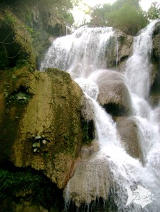 Kuang Si (Xi) Waterfall with three tiers leading to a 50-metre drop into spectacular azure pools.