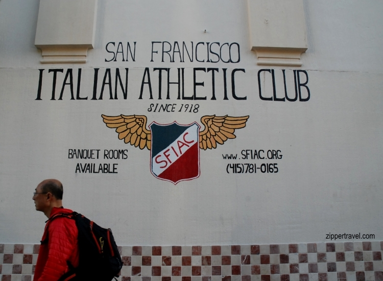 man walking past italian athletic club north beach san francisco california