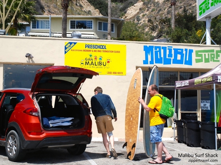 men loading surfboards into car malibu surf shack malibu california