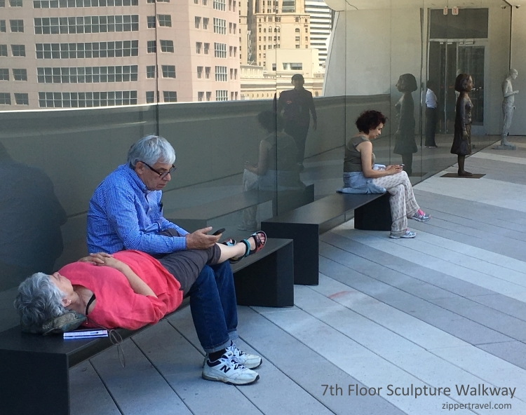 lady lying on bench sculpture walkway SFMOMA