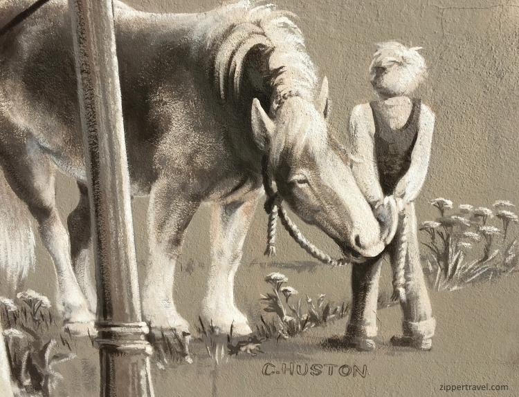 C. Huston mural boy holding horse Cottage Grove Oregon