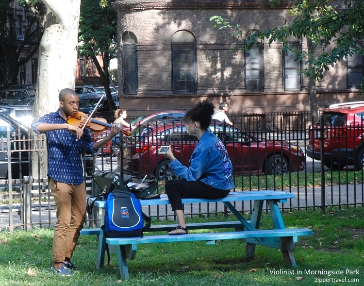 woman recording boy playing violin Morningside Park Harlem NYC