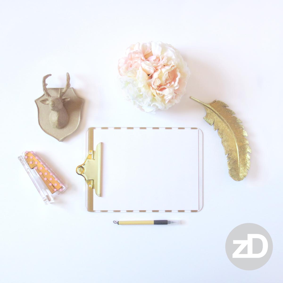 Zirkus Design | Photographing Flat Lay Product Mockups | Feminine Desk with Pink Stapler and Gold Feather