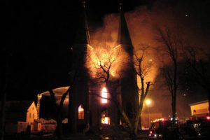 The only church that illuminates is a burning church