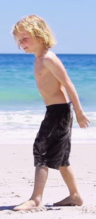 Boy with shorts at beach