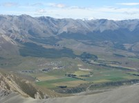 From near point 1842m, looking down on the rocks of Castle Hill and across to Cheeseman Skifield road with Mt. Rolleston visible behind