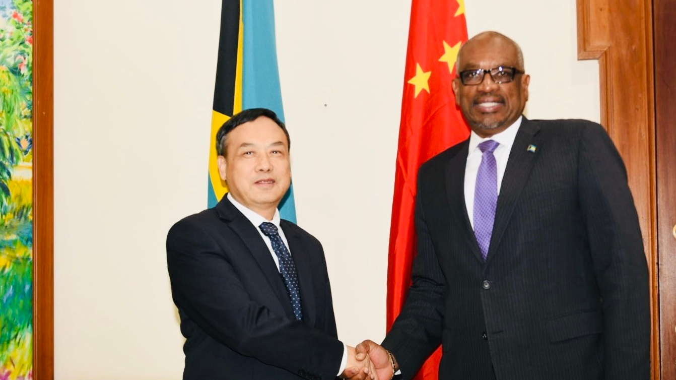 Image result for Prime Minister Dr. Hubert Minnis (Right) and Chinese Ambassador Huang Qinguo