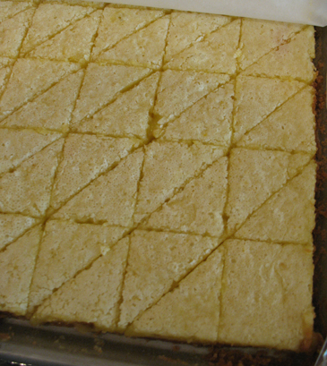 Lemon meringue bars cut into triangles | ZoëBakes | Photo by Zoë François