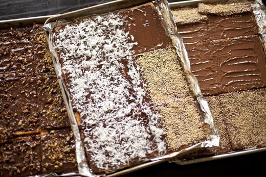 Adding toppings to your matzohs | Chocolate Caramel Matzo | Photo by Zoë François