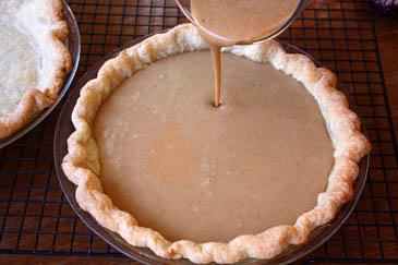 Pouring sweet potato pie filling into baked crust   ZoëBakes   Photo by Zoë François