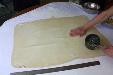 Rubbing butter on stretched strudel dough | ZoëBakes | Photo by Zoë François