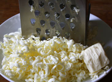 Plate of grated butter next to grater | ZoëBakes | Photo by Zoë François