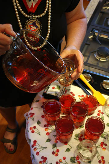 Barb Schaller filling jars with peach-raspberry jam