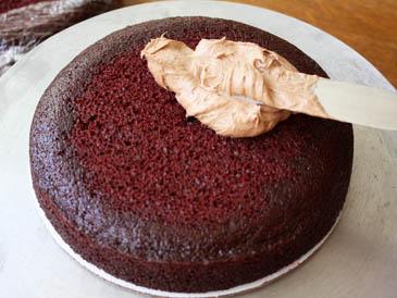 Spreading icing on red velvet cake | ZoëBakes | Photo by Zoë François