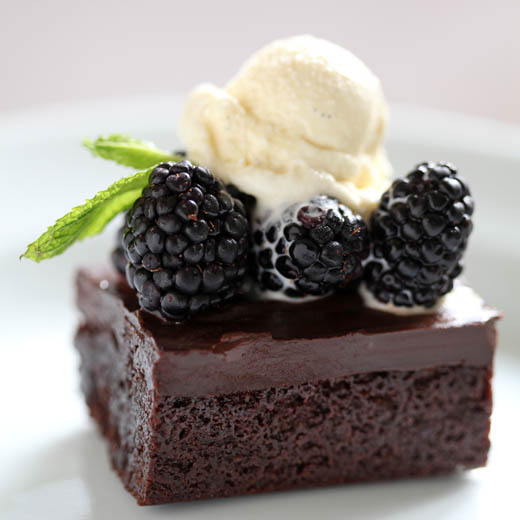 Gluten free chocolate brownie topped with blackberries and mint ice cream   ZoëBakes   Photo by Zoë François