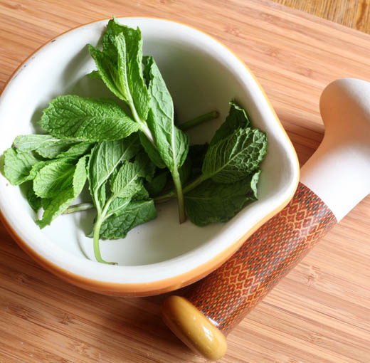 Mint leaves in mortar and pestle | ZoëBakes | Photo by Zoë François