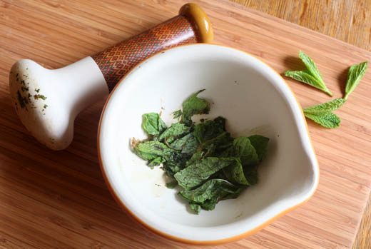 Mint leaves crushed in mortar and pestle | ZoëBakes | Photo by Zoë François