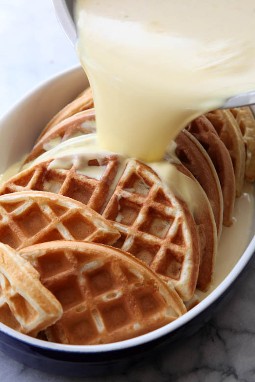 Soaking waffles in custard for waffle bread pudding | photo by Zoë François