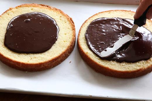 Spreading ganache between layers of cake | ZoëBakes | Photo by Zoë François