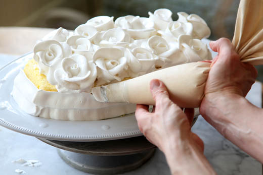 Piping Roses on Lemon Meringue Cake | ZoeBakes | Photo by Zoë François