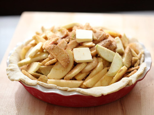 The best apple pie recipe - apple mixture placed in the pie crust | photo by Zoë François