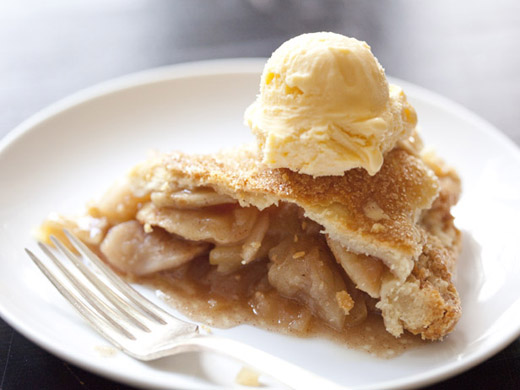 A slice of the best apple pie with a scoop of vanilla ice cream | photo by Zoë François