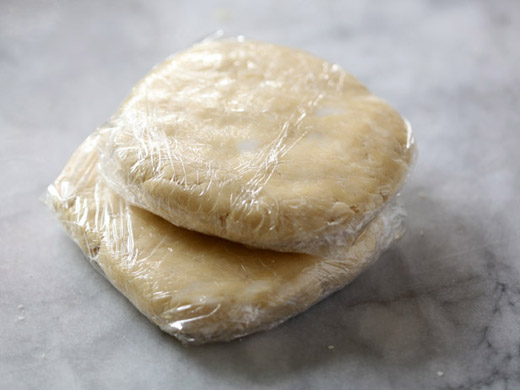 The best apple pie recipe - dough disks wrapped in plastic wrap, ready for the fridge | photo by Zoë François