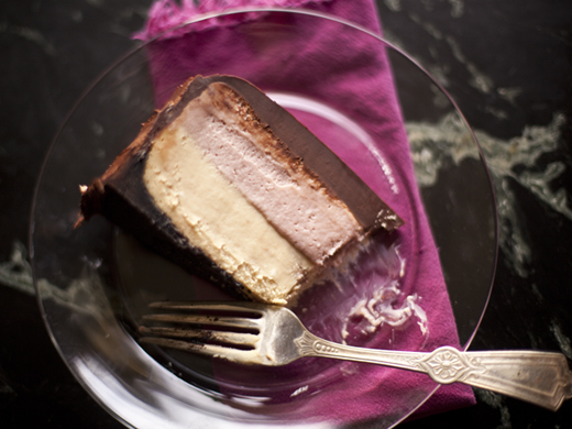 Slice of peanut butter and jelly cheesecake with chocolate ganache | ZoëBakes | Photo by Zoë François