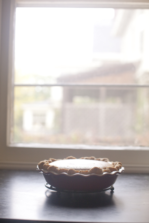 Caramel Apple Pumpkin Pie on a cooling rack by the window | ZoeBakes | Photo by Zoë François