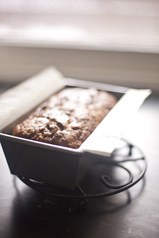 Nutella Swirled Banana Bread recipe - one loaf cooling on a rack on a countertop | photo by Zoë François