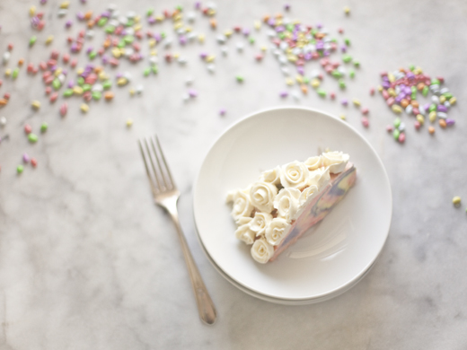Slice of Easter Cheesecake piped with white buttercream roses | ZoëBakes | Photo by Zoë François