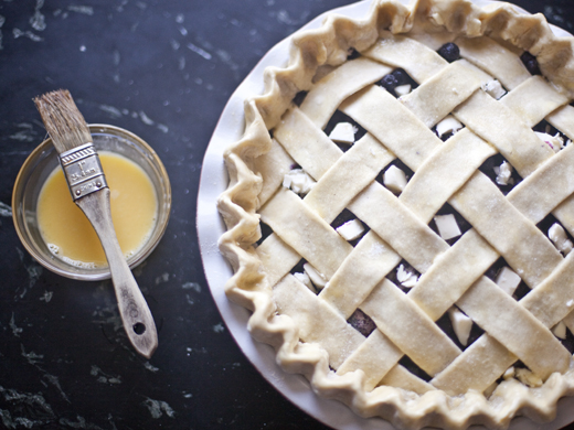 Blueberry Pie Recipe - unbaked lattice-topped blueberry pie with pats of butter, ready for the oven | photo by Zoë François