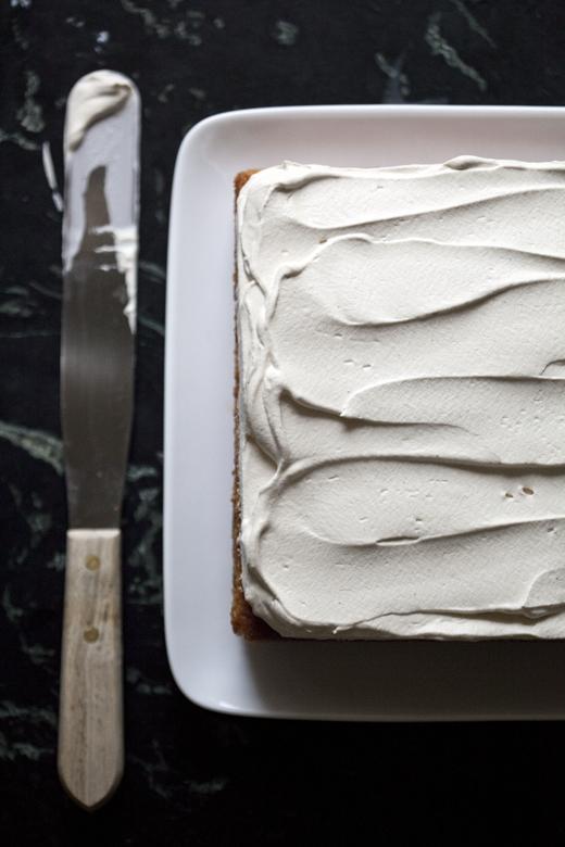 Spreading Whipped Cream on Tres Leches | ZoëBakes | Photo by Zoë François