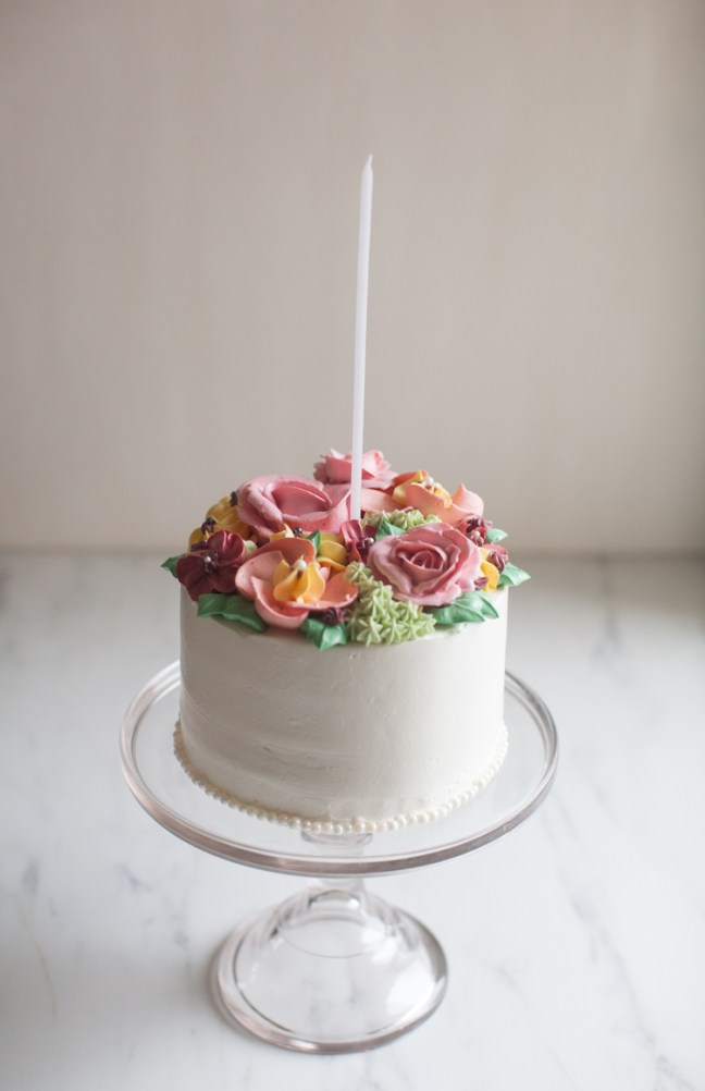 Layer cake with piped frosting flowers