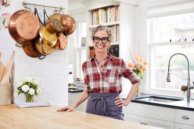 Zoë François standing in her Minneapolis kitchen.