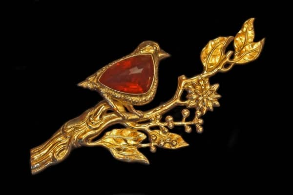 Featuring a fine art jewelry bird brooch