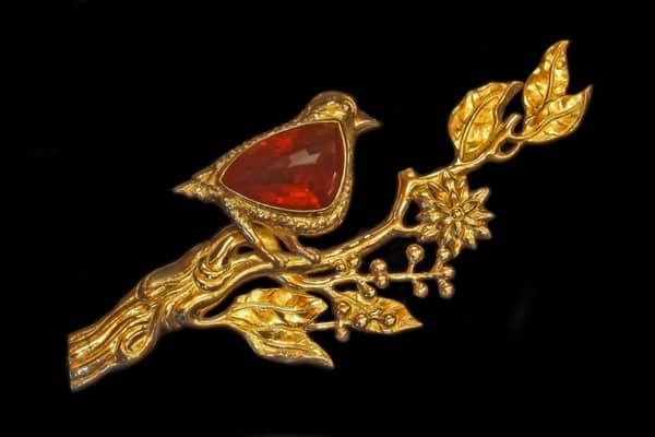 Inspired Symbol Jewelry featuring a fine art jewelry bird brooch. Photo by Zoein Jewels designer Shunyata