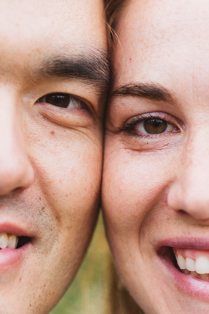 close of couples faces