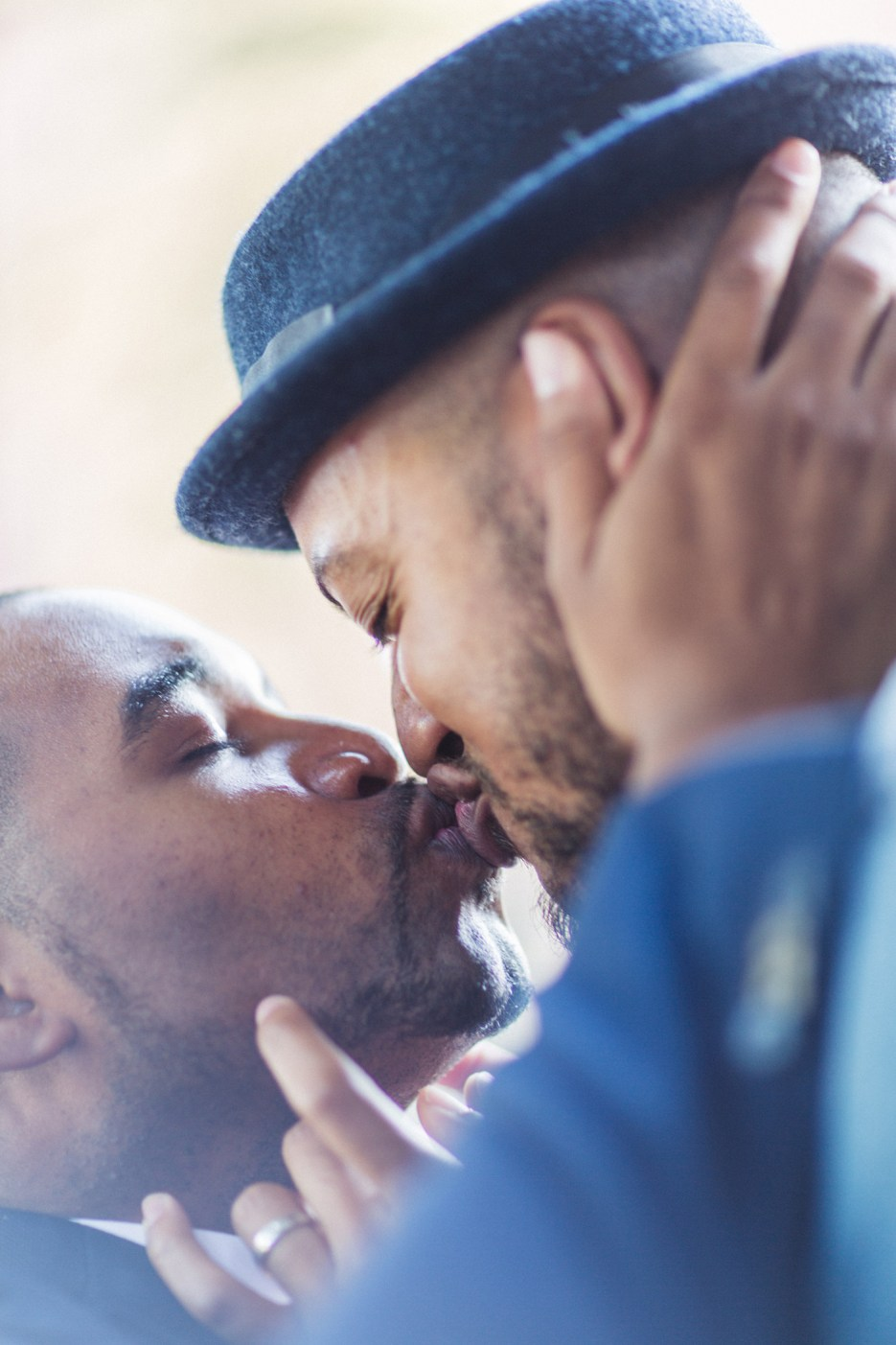 kissing close up two men in love at engagement photo session