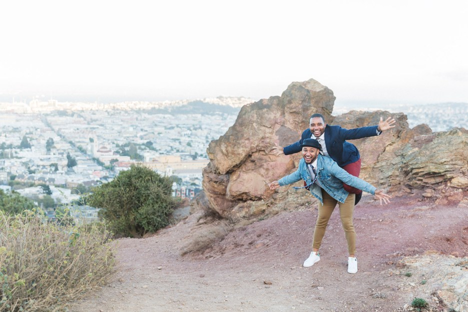 william and shawn piggybacking at corona heights san francisco overlooking city