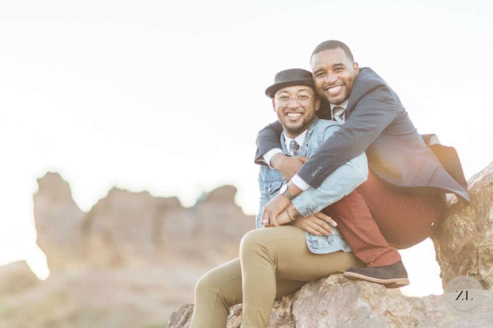 same sex engagement photography inspiration with a black, gay couple hugging each other