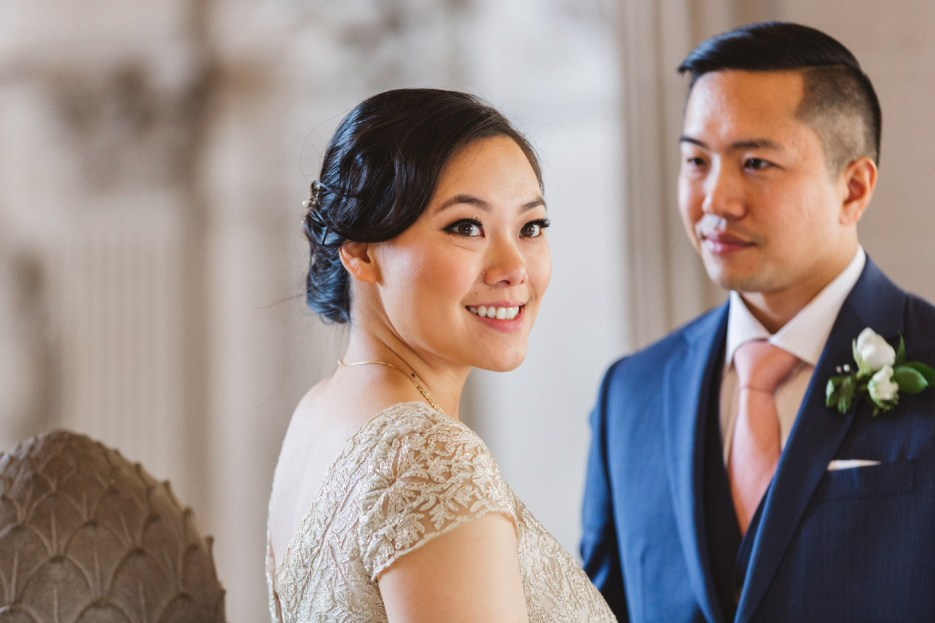 bride turns away for portrait shot of newlywed couple